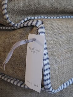 Welting detail on Quatrine slipcovers - burlap and ticking look great together