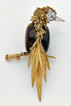 """Great clip STERLE yellow gold and platinum """"bird"""" composed for the body of a pattern of half """"tiger eye"""" half """"laborite"""" and set with brill ..."""