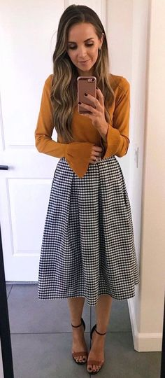 #fall #outfits women's brown trumpet sleeve top and black and white tattersal midi skirt #churchoutfits