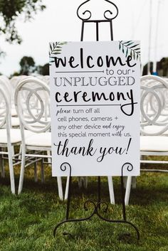 Modern wedding sign idea - Unplugged ceremony sign with modern font and tropical leaf motif {Aster & Olive Photography}