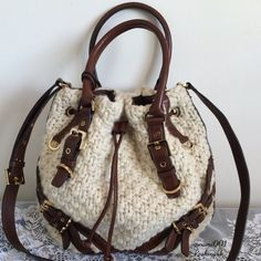 """Michael Kors Milo Wool Knit Purse & Crossbody EUC This chic and trendy knit purse by Michael Kors is elegance at it's finest. Quickly selling out, this was one of MK's most popular handbags. Comes to you w/dustcover and in EUC with no stains or pilling. Rich leather accents with gold hardware & hanging MK logo. Measures: 14"""" x 10"""" x 6"""". Handle drop 6"""". Adjustable crossbody strap that isn't detachable. 1 zippered pocket & 4 slip pocket. Drawstring closure & magnetic snap. Comes with…"""