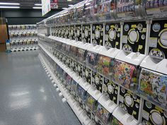 "Gashapon vending machines at Yodobashi Camera in Osaka, Japan.  Gashapon (ガシャポン) or gachapon (ガチャポン), also referred to as ""capsule toy"", is a Japanese onomatopoeia, made up of two sounds: ""gacha"" for the turning of a crank on a toy vending machine, a"