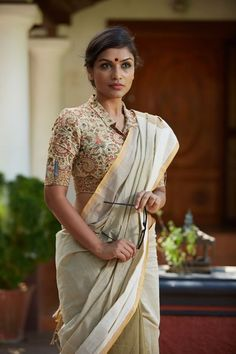 Formal shirt blouse with a button down front is emboldened by patch pockets on both sleeves. A statement piece THE KALAMKARI EDITION Handwoven, designed . Indian Saree Fashion via Kalamkari Blouse Designs, Saree Blouse Patterns, Sari Blouse Designs, Blouse Styles, Kalamkari Blouses, Modern Blouse Designs, Best Blouse Designs, Kalamkari Saree, Blouse Back Neck Designs