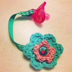 Uses ribbon, a flat metal hair clip, Velcro. I crocheted flowers and attached the button, then hot glued it to felt backing, then to the hair clip. Crochet Children, Crochet For Kids, Crochet Pacifier Clip, Crocheted Flowers, Metal Hair Clips, Crochet Necklace, Ribbon, Babies, Homemade