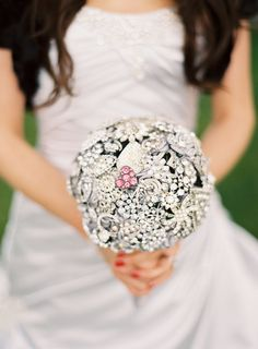 Brooch bouquet.  A friend of mine did this and included brooches from late relatives to include those who couldn't be there on her wedding day.  It was beautiful and meaningful!