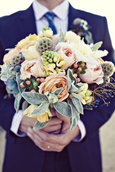 Amazing bouquet with peach, pink and mint green. As seen on Southern Weddings. #wedding #flowers #bouquet