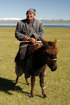 A nomad herder on his donkey at Song Kul lake, one of the most beautiful places in Kyrgyzstan - and considering how beautiful Kyrgzystan is... - plan to stay the night in a yurt and enjoy nature and peace - Click to open the guide with many photos and detailed information to plan your visit