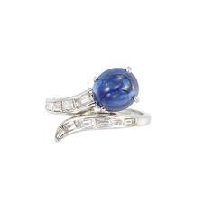Platinum, Cabochon Sapphire and Diamond Ring   One oval cabochon sapphire ap. 3.90 cts., 12 baguette & tapered baguette diamonds ap. .75 ct., no. 22252, ap. 3.5 dwt.