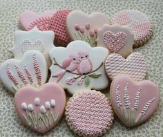 Pink and White Decorated Sugar Cookies With Royal Icing With Springtime Theme.