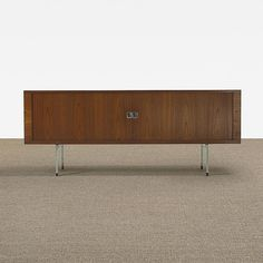 Hans Wegner cabinet, model RY 25  RY Møbler  Denmark, c. 1960  teak, matte chrome-plated steel  78.75 w x 19.5 d x 31.5 h inches  Cabinet features two tambour doors concealing six pull-out trays, three adjustable shelves, one fixed shelf and one flip-top compatment. Signed with Danish control tag to reverse.