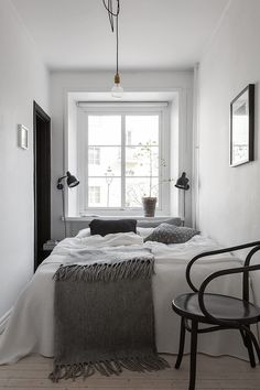 Small bedroom styling in the monohcome home of Swedish interior stylist Elin Kickén