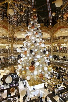 2015 Christmas tree stands in the middle of Galeries Lafayette ...