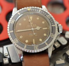 6044 Brown dial 5512 Submariner | Vintage Watches from James Dowling