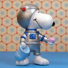 It's career week with Snoopy & Belle! Today Snoopy is flying to the moon to fill his back with pink moon rocks. Find him in our shop at CollectPeanuts.com. Stay tuned! We'll be bringing you a new photo everyday