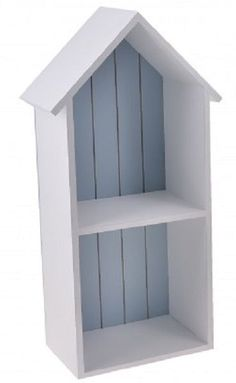 Elegant Nautical wall hanging wooden beach hut shaped shelving unit in white with a blue painted background