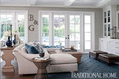 Love this sectional and grasscloth wallpaper.  The color palette is beautiful!