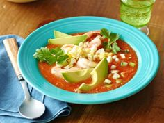 Garnish Ree's traditional Gazpacho with grilled shrimp, avocado slices, minced hard-boiled eggs and cilantro leaves.