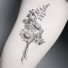Love these dainty flowers! British flowers make me so happy and remind me of summers camping in the country :) Black floral tattoos are so fashionable and for good damn reason - love delicate tattoos like this.