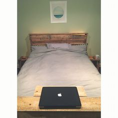 Recycled pallet bed frame, toe board and head board with integrated lights.