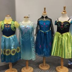 A look at new #frozenfever dresses for Elsa and Anna with their #frozen coronation dresses from Jakks Toys