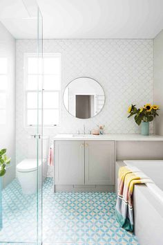 Fresh, fun bathroom with great combination of colourful tiles - a mixture of scallop tiles and patterned floor tiles Aqua Bathroom, White Bathroom Cabinets, Scallop Tiles, White Wall Tiles, Turquoise Tile, Amazing Bathrooms, Modern Bathrooms, Floor Patterns, Bathroom Renovations