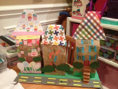 Brown paper bag houses/neighborhood. Great project for preschool age kids on a cold winter day. Did these with my 4-year-old today. Materials: brown paper bags, construction paper, scrapbook paper, ribbon, markers, crayons and glue stick.