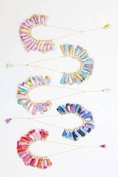 We're crazy for DDSLLGirlsStore's multicolored leather tassel necklaces. Read about the makers who bring these beauties to life in our studio tour on the Etsy blog. #etsy #makerstory