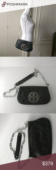 "TORY BURCH Black Genuine leather Crossbody bag TORY BURCH Black Genuine leather Crossbody bag. Black leather Tory Burch fold-over shoulder bag with gold-tone hardware, single chain-link and leather shoulder strap, large logo placard at front, single exterior zip pocket under flap, beige canvas lining, single interior zip pocket and fold-over flap closure. Measurements: Shoulder Strap Drop 21"", Height 7"", Width 11"", Depth 0.5"" Check picture 2 to see the little scratch on the hardware.  ⭐Great…"