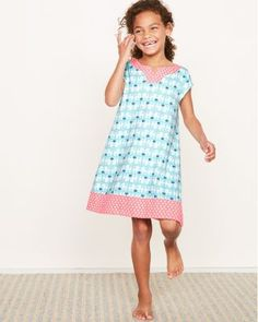 Our colorful mixed-print nightgown is boldly beautiful. Styled like a daytime dress with an easy A-line shape, a pretty notched neckline, cap sleeves, and a dramatic band at the hem. Coordinates with our Mixed-Print sleepwear. Crafted in our exclusive blend of flame-resistant and supersoft modacrylic and eco-friendly Green Cotton.Relaxed fitPull-on styleNotched necklineCap sleeves3 band at hemKnee lengthFlame-resistant modacrylic/Green cottonImported