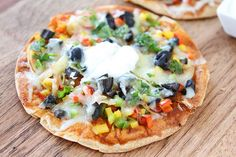 Open Faced Enchilada Veggie Quesadillas. The quesadillas are loaded with colorful veggies and melty cheese! And the sour cream adds the perfect amount of creaminess. Fun to make and eat! This is a great recipe for adults and the kiddos.