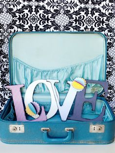 Spell out L-O-V-E or any word using inexpensive chipboard or wood letters covered in decorative paper. Use finished letters to create a banner or mantel display.