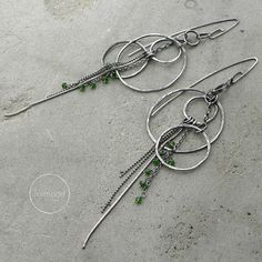 Earrings are totally made of oxidized sterling silver 925 and Tsavorite or Ruby (3mm) Dimensions: Total length: 5.12 (13 cm) Silver circles: 0.63 - 1.42 (16-36 mm) Weight: 3.6 g TO USE DISCOUNT, YOU NEED TO ADD TO YOUR CART PRODUCTS WITH MINIMUM PRICE OF 150$ AND USE THE COUPON150 We pack all items in corporate boxes (visible in some offers). We ship all consignments as priority registered consignments in well protected cartons. Thank you for visiting