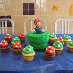 Mario pipe cake with mushroom cupcakes
