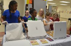 Boys & Girls Club of Langston Hiughes members serving cookies at their annual spaghetti dinner.