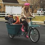 """Every family needs an MADSEN cargobike, also known as """"bucket bike"""". This beautiful utility bicycle holds 650 pounds of cargo, with seat belts for 4 children."""