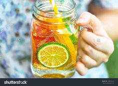 Woman holding refreshing water with fruits. Fruits juice. Lemonade in jar. Fruit photography. Stock photography, images, pictures, Illustrations. Healthy food. Diet and Detox. Fresh Juice. Fruit Images Download.