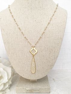 A personal favorite from my Etsy shop https://www.etsy.com/listing/517189755/clover-necklace-long-necklace-gold