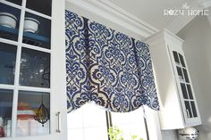 No sew window shades with wood header, not lined. She used sheer organza ribbon (instead of contrast) and simple knot.