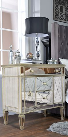Echoing the opulence of Art Deco style, this dresser is finely crafted with antiqued mirror panels and silver-finished wood. Shop online now. #LivingSpaces