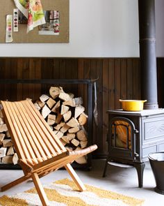 woodstove + mid-century folding chair