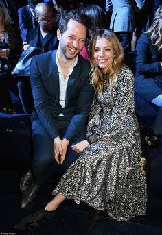 Stunner: Sienna looked chic as ever as she sat next to Derek Blasberg...