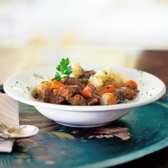 Comfort on a cold winter night -- polenta adds a grainy earthiness to traditional beef stew.