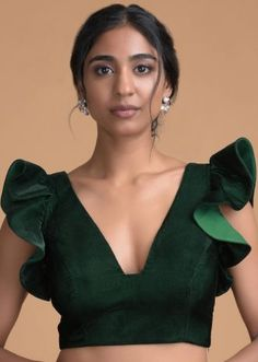 Forest Green Blouse In Velvet With Trapeze Neck And Ruffle Sleeves Online - Kalki Fashion Saree Blouse Neck Designs, Saree Blouse Patterns, Fancy Blouse Designs, Indian Blouse Designs, Shagun Blouse Designs, Kurti Back Neck Designs, Traditional Blouse Designs, Choli Blouse Design, Dress Patterns