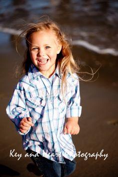 laugh play fun children girl beach  www.KeyandHeartPhotography.com