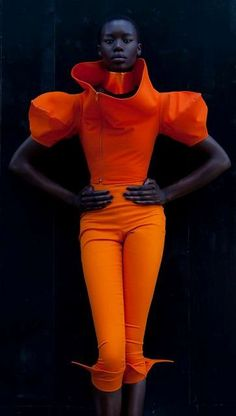 bright orange jumpsuit, huge open collar with a separate matching choker.