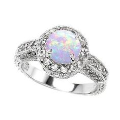 Opal engagement rings? I would love to see this in a fashion magazine!