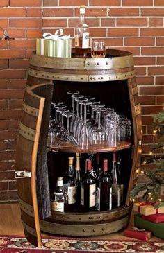 Wine barrel bar table and many other DIY furniture made from wooden barrels . build your own wooden barrel diy furniture wine glasses storage space wine bottles More ideas like this project @ co. Wine Barrel Bar Table, Wine Barrels, Whiskey Barrel Bar, Wine Barrel Diy, Diy Furniture Making, Furniture Ideas, Furniture Dolly, Cabinet Furniture, Unique Furniture