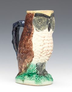 A Majolica Owl Pitcher Charming ceramic pitcher in the shape of a standing owl on mound base glazed in polychrome clear glazes marked with two green slashes in glaze underneath (decorator's marks). Bird People, China Teapot, Creative Arts And Crafts, Ceramic Pitcher, Owl Art, Pottery Art, Tree Branches, Pet Birds, Stoneware