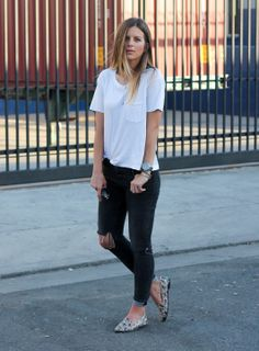 A simple white shirt and black distressed jeans can never go wrong. Michelle Madsen tops it off with accessories to give it that extra pop. #Fashion #StreetStyle #ootd