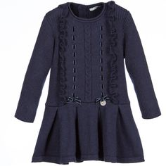 Baby girls navy blue knitted dress by Mayoral Chic. This soft and cosy cotton and angora blend is ribbed, with long sleeves and ruffle trim, laced with pretty navy blue velvet ribbons. It has two velvet bows at the waist and a silver logo charm, a pleated skirt and button fastening at the back.<br /> <ul> <li>60% cotton, 30% polyamide, 10% angora (soft, cosy knit)</li> <li>Hand wash</li> <li>Designer colour: Navy</li> </ul>